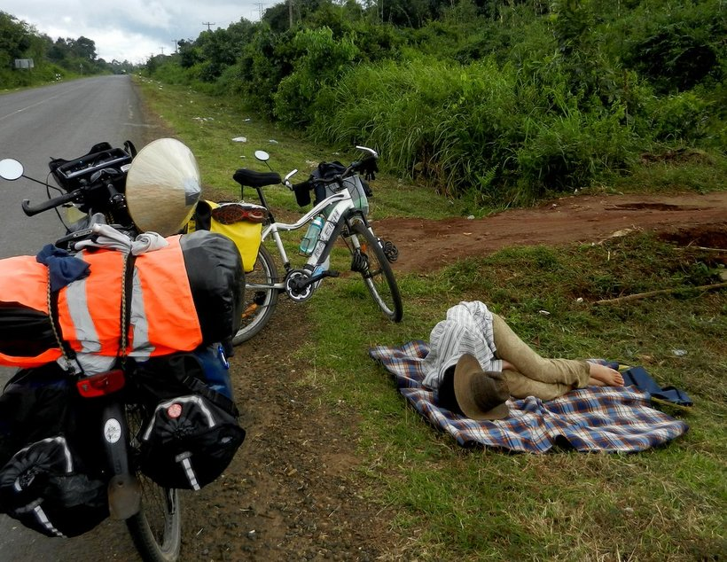 Lying on the roadside, sleeping from exhaustion